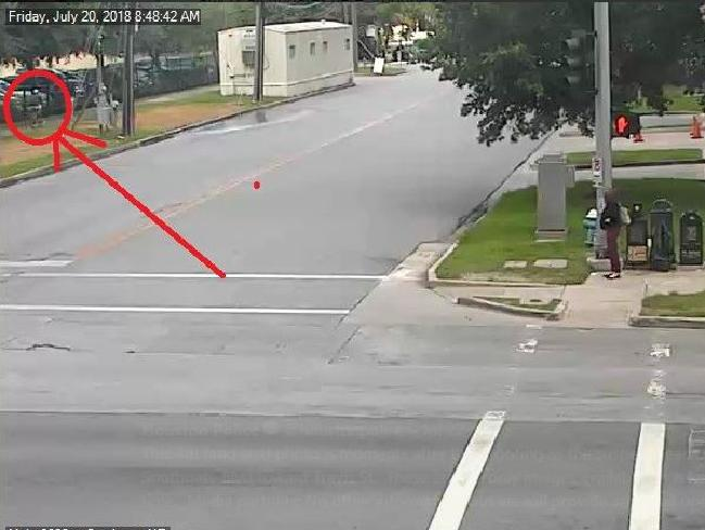 CCTV footage captured the killer (circled in red) stalking his victim before opening fire. Picture: Houston Police Department