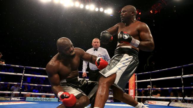Dereck Chisora puts Carlos Takam down during their heavyweight title fight. (Photo by Ben Hoskins/Getty Images)