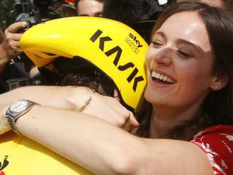 Sarah Elen hugs her husband Britain's Geraint Thomas, wearing the overall leader's yellow jersey, after the twentieth stage of the Tour de France cycling race.