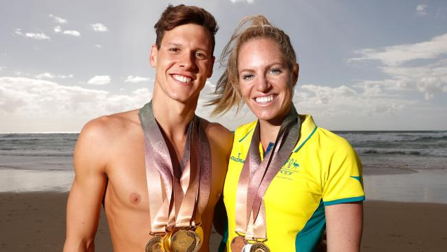 ATTENTION WARNING SUNDAYS ONLY..... Mitch Larkin and partner Emily Seebohm pose for a photograph during a swimming portrait session at the Gold Coast 2018 Commonwealth Games on April 11, 2018. (Photo by Michael Willson)