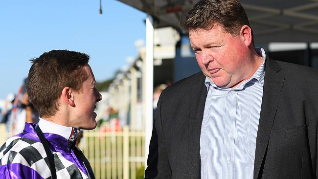 Jackson Murphy speaks to trainer Steven O'Dea (right) after riding Sabkhat to victory. Picture: AAP
