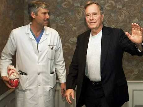 US Ex-president George HW Bush with cardiologist Mark Hausknecht (left) who treated him for an irregular heartbeat. Picture: AP