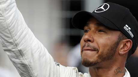 Mercedes driver Lewis Hamilton celebrates after securing pole position for the Hungarian Grand Prix.