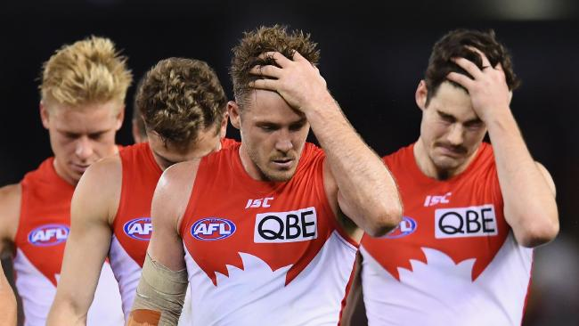 The Swans trudge off after losing to the Bombers. (Photo by Quinn Rooney/Getty Images)