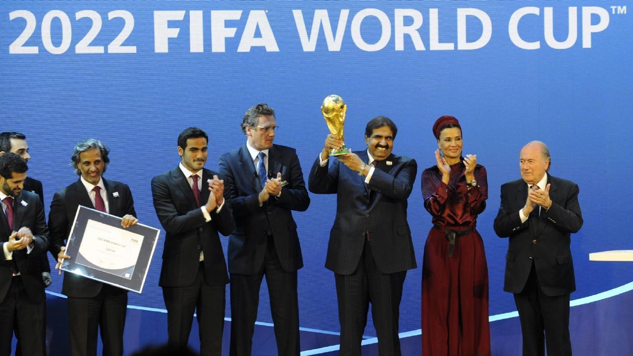 The delegates from FIFA celebrate winning the 2022 World Cup. (AP Photo/Keystone, Walter Bieri)