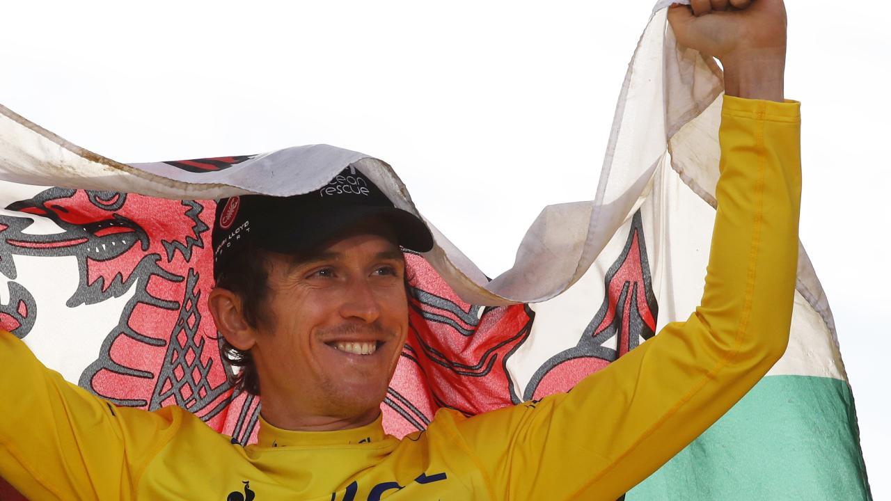 Proud Welshman Geraint Thomas celebrates his Tour de France victory. (AP Photo/Christophe Ena )