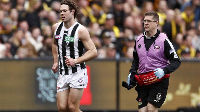 Matthew Scharenberg leaves the ground injured during the game against Richmond.
