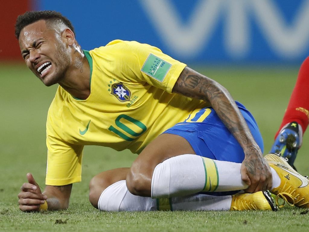 Neymar holds his leg during the quarter-final match against Belgium. (AP Photo/Francisco Seco, File)