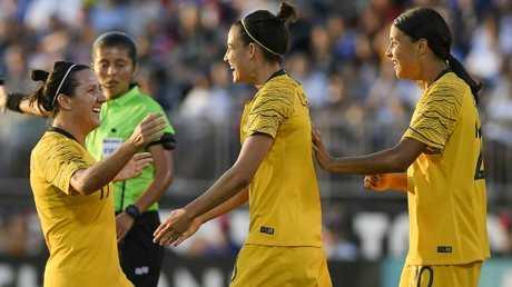 Chloe Logarzo (middle) and Lisa De Vanna (left) combined for Australia's opening goal.