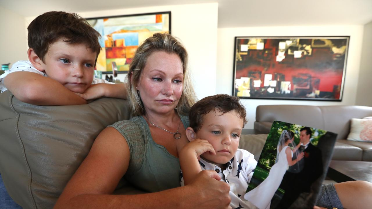 Danica Weeks with her two children l-r Lincoln, and Jack look at a picture of the couples wedding in 2007, at their home in Mt Coolum, Sunshine Coast. Picture: Lyndon Mechielsen/The Australian