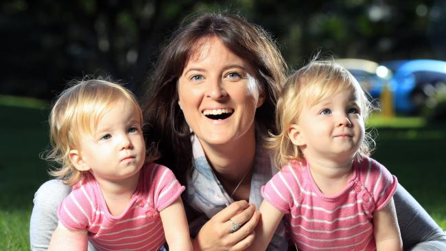 Susannah Boyd from Rochedale with twin daughters Zoe and Madison, 18 months. Picture: Lachie Millard