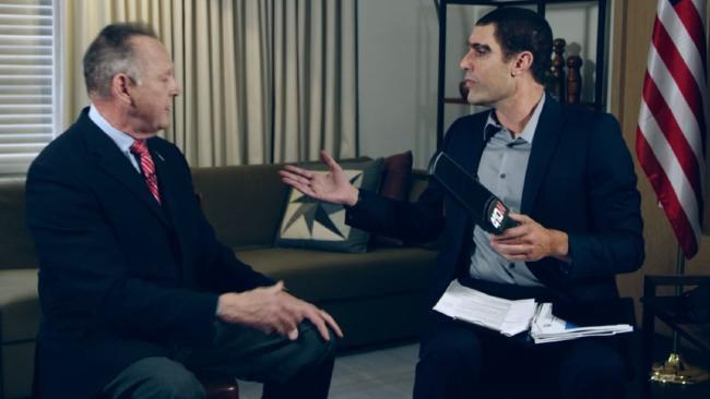 Sacha Baron Cohen shows Moore the 'paedophile' detector.