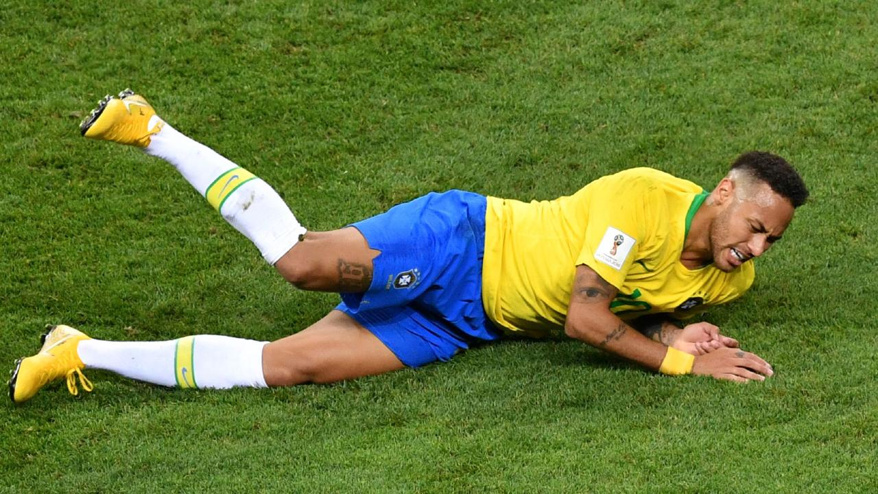Brazil's forward Neymar falls down during the Russia 2018 World Cup quarter-final.