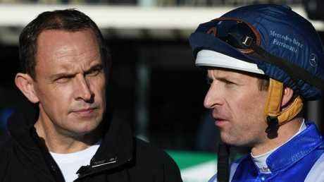 Chris Waller (left), trainer of Winx, and regular jockey Hugh Bowman after the mare returned in a barrier trial at Rosehill last week. Pic: AAP