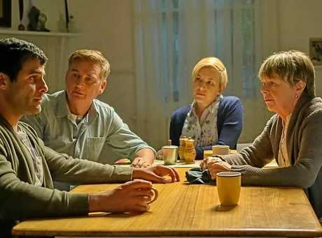 THE MERGER: A scene from the new movie with Penny Cook (right hand side), next to her screen husband John Howard.