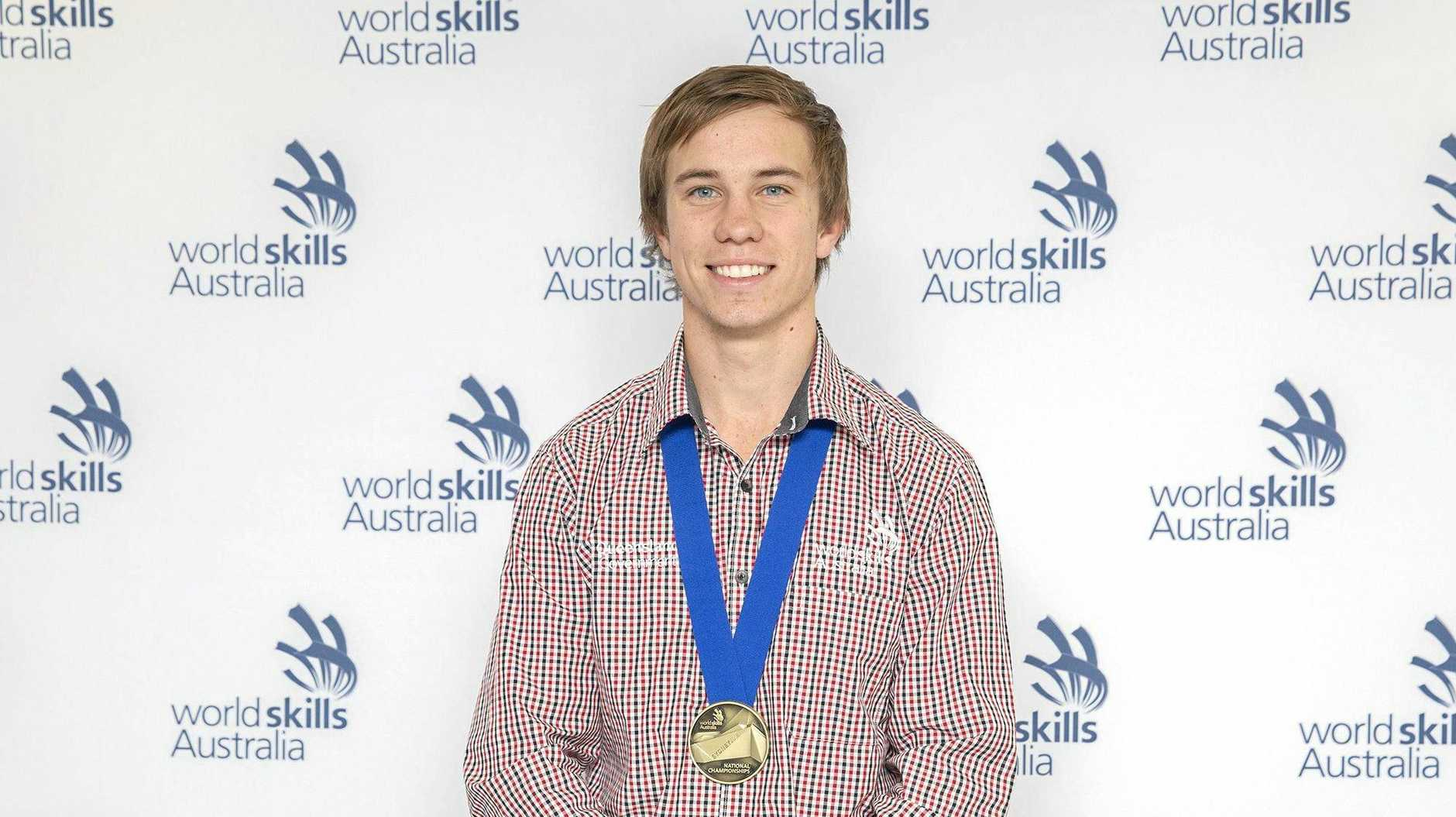 HIGH ACHIEVER: Pie Creek apprentice Patrick Brennan poses with his WorldSkills Australia gold medal at the national championships in Sydney.
