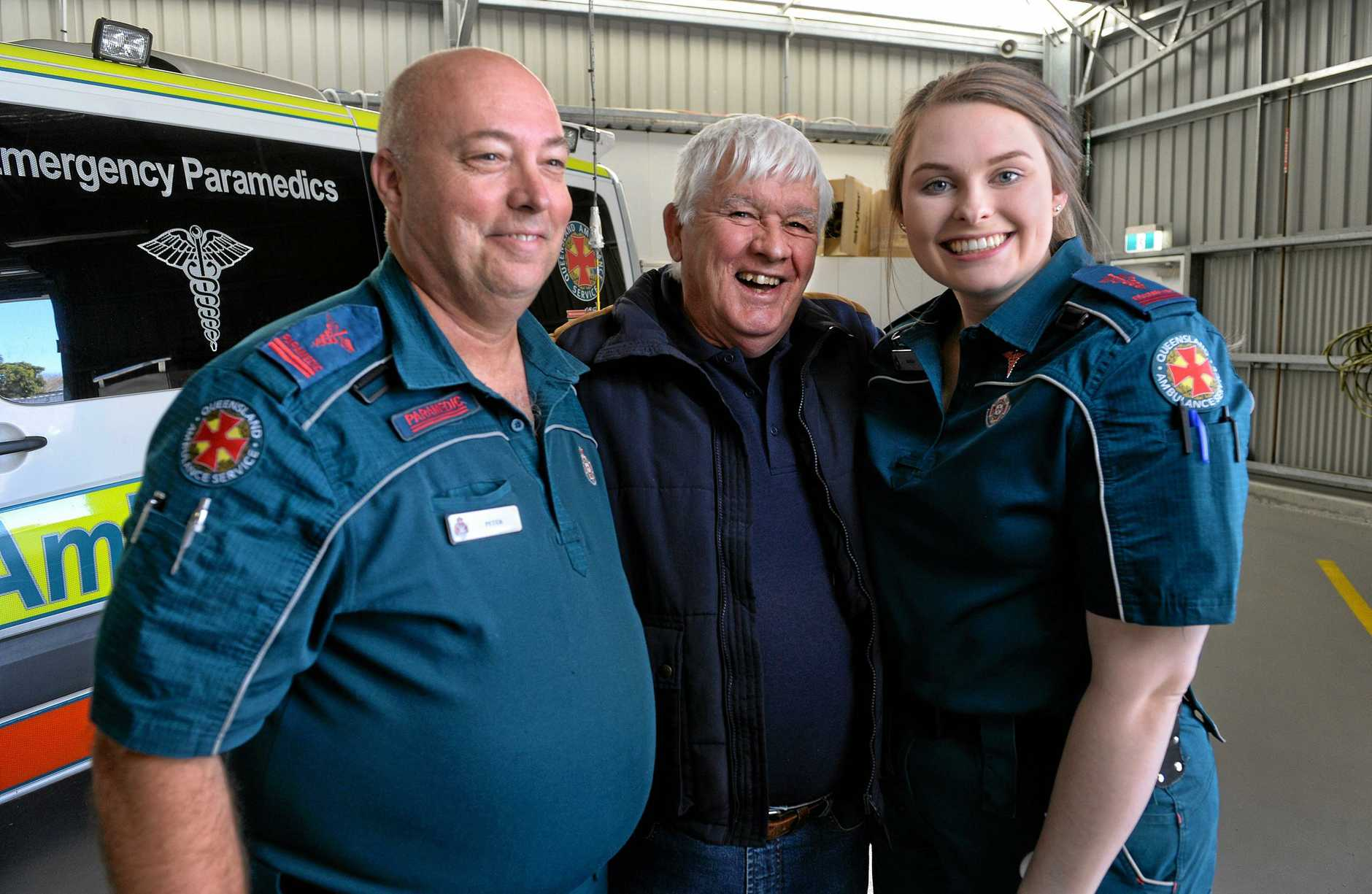 THANKS: Dan Fowler (middle) is greeted by Lowood paramedics Peter Brown and Kayla Yarrow, who treated him following after a plane crash.