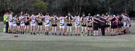 On Saturday, colts, reserves and seniors from both Caloundra and Mayne AFC linked arms as one in tribute to Corey Stenzel.