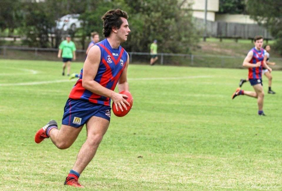 Sunshine Coast and Gladstone Aussie Rules communities are reeling following the shock death of a much-loved player.