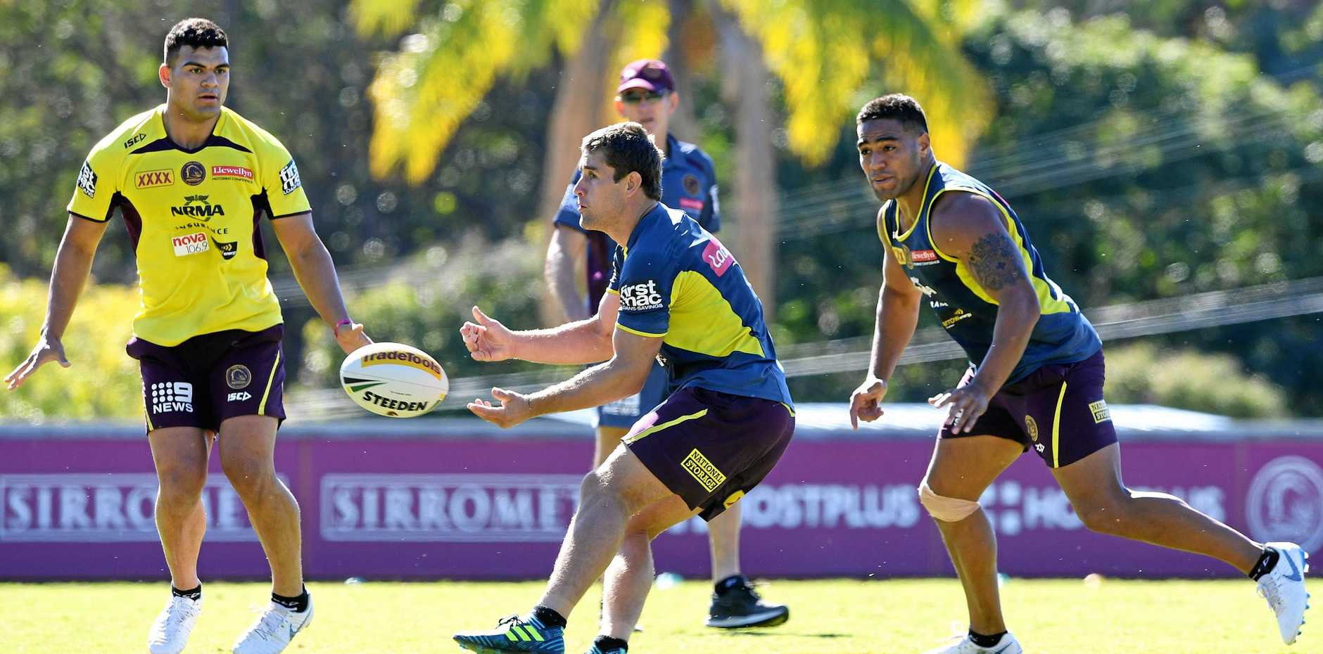Andrew McCullough passes the ball during a Broncos training session on Monday.