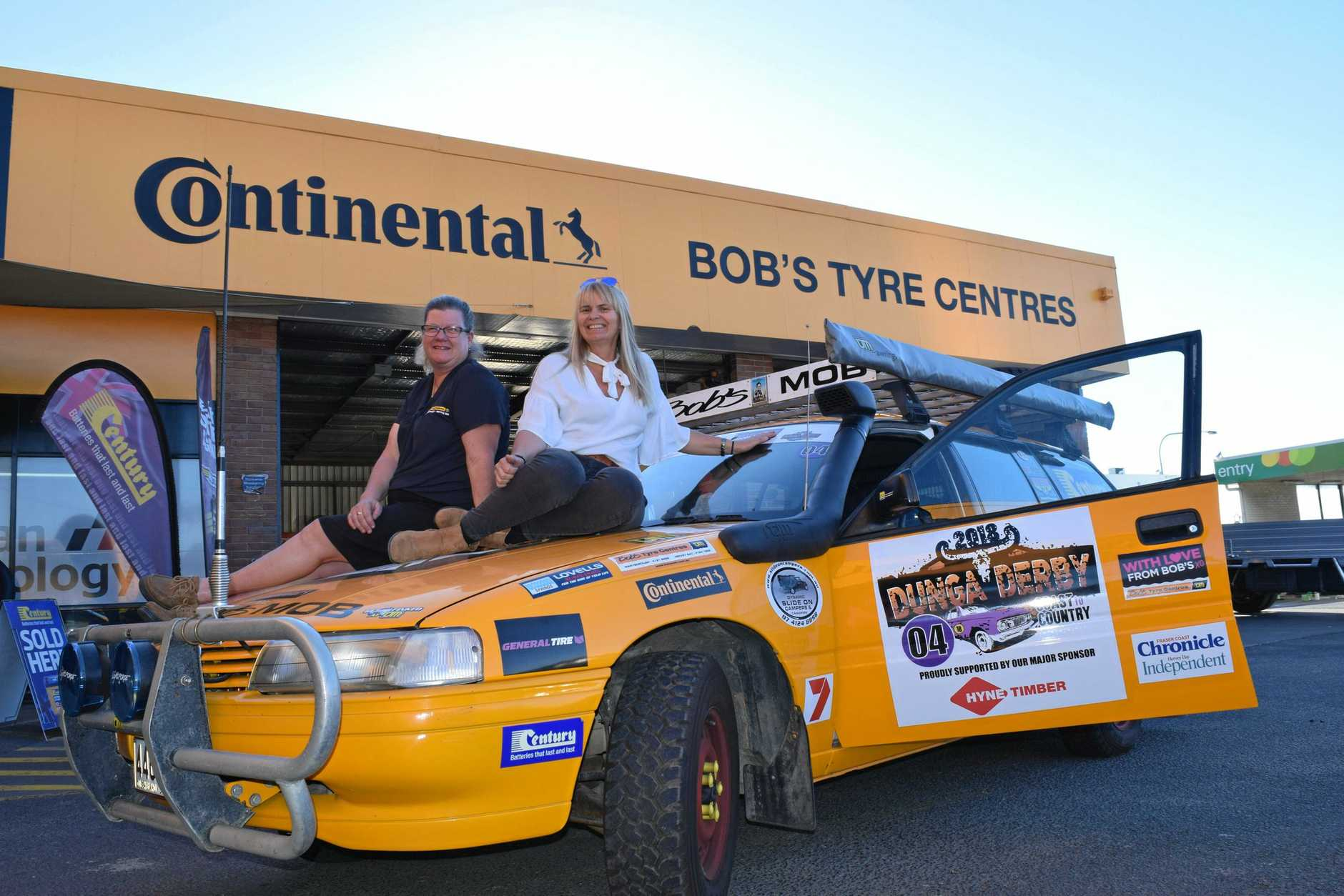 MRS BOBS MOB: Narelle Wicks and Sue Edward with their car Mrs Bob's Mob ahead of the 2018 Dunga Derby. Fellow driver Janelle Horne is absent.