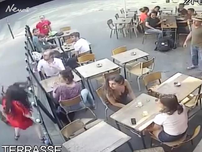 The moment the student, bottom left in red, is punched by a male.