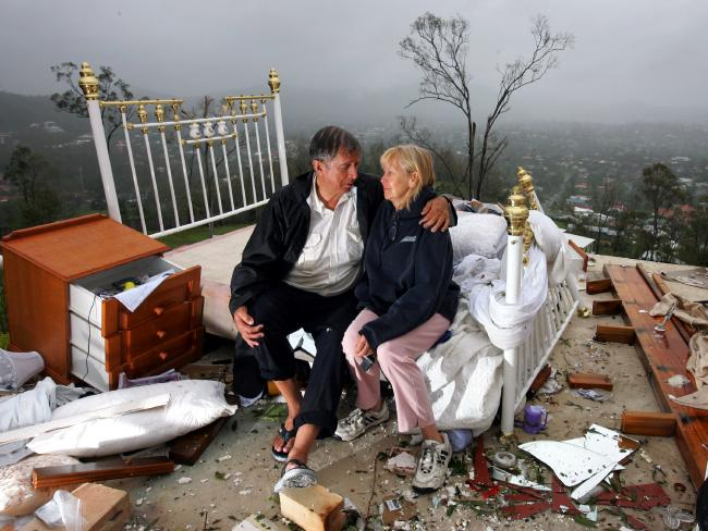 Graham and Lynette Bigby console each other after their Gap home was demolished in 2008.