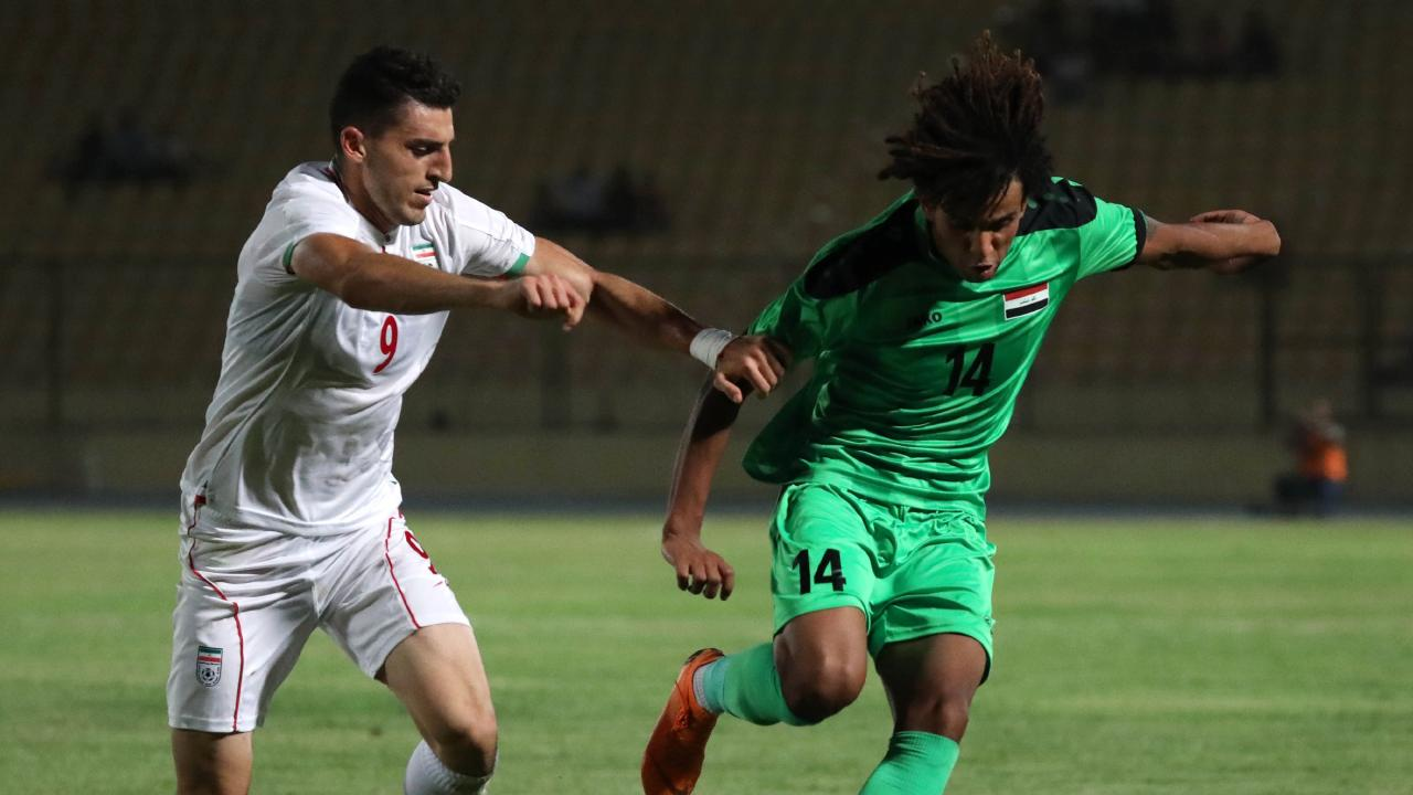 An Iraqi youth player, right, in action against Iran. Picture: Mazin Fayadh
