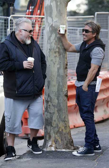 John Ibrahim shares a laugh with mate Kyle Sandilands who was refused entry at the former nightclub owner's home as police executed a raid on Tuesday. Picture: MATRIX