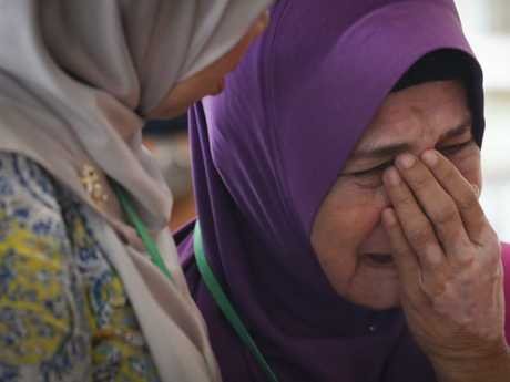 Sarah Nor, the mother of passenger Norliakmar Hamid, sobbed after attending a briefing on the report in Malaysia. Picture: AP Photo/Vincent Thian