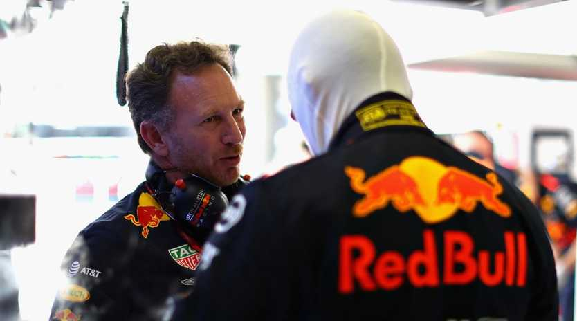 Red Bull Racing Team Principal Christian Horner talks with Max Verstappen before the Formula One Grand Prix of Hungary. Picture: Mark Thompson/Getty Images
