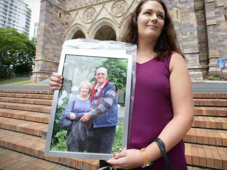 Family members said the report left too many questions unanswered. Pictured, Karla McMaster attends a memorial with a photograph of her parents Rod and Mary Burrows. Picture: Jamie Hanson