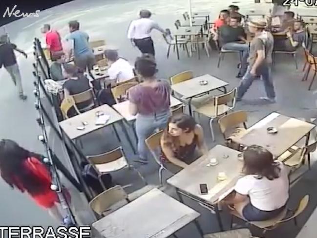 The attacker, top far left, walking away after the assault.