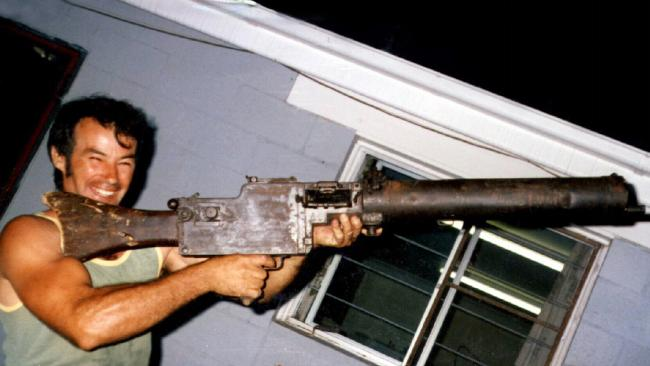 Ivan Milat is pictured holding a World War I vintage machine gun in 1983.