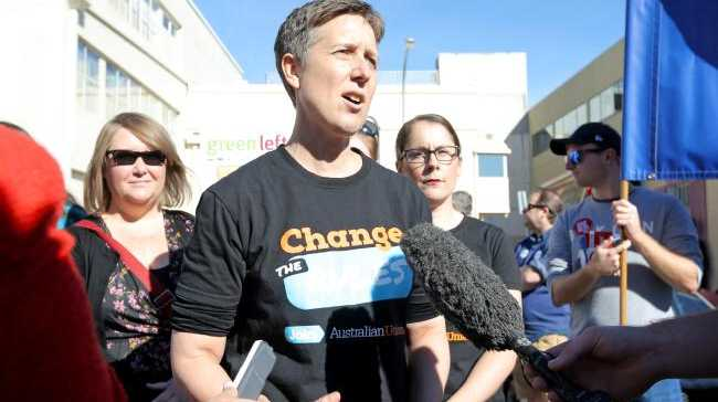 ACTU secretary Sally McManus addresses a May Day march on the 'Change the Rules' campaign.