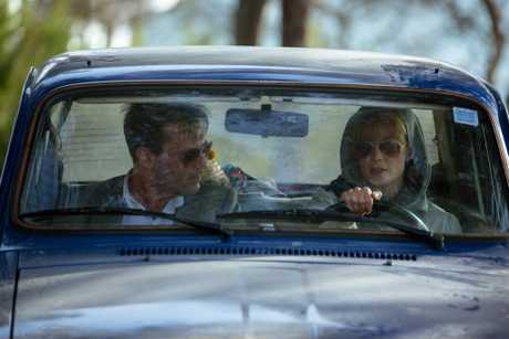 Jon Hamm and Rosamund Pike in a scene from Beirut.