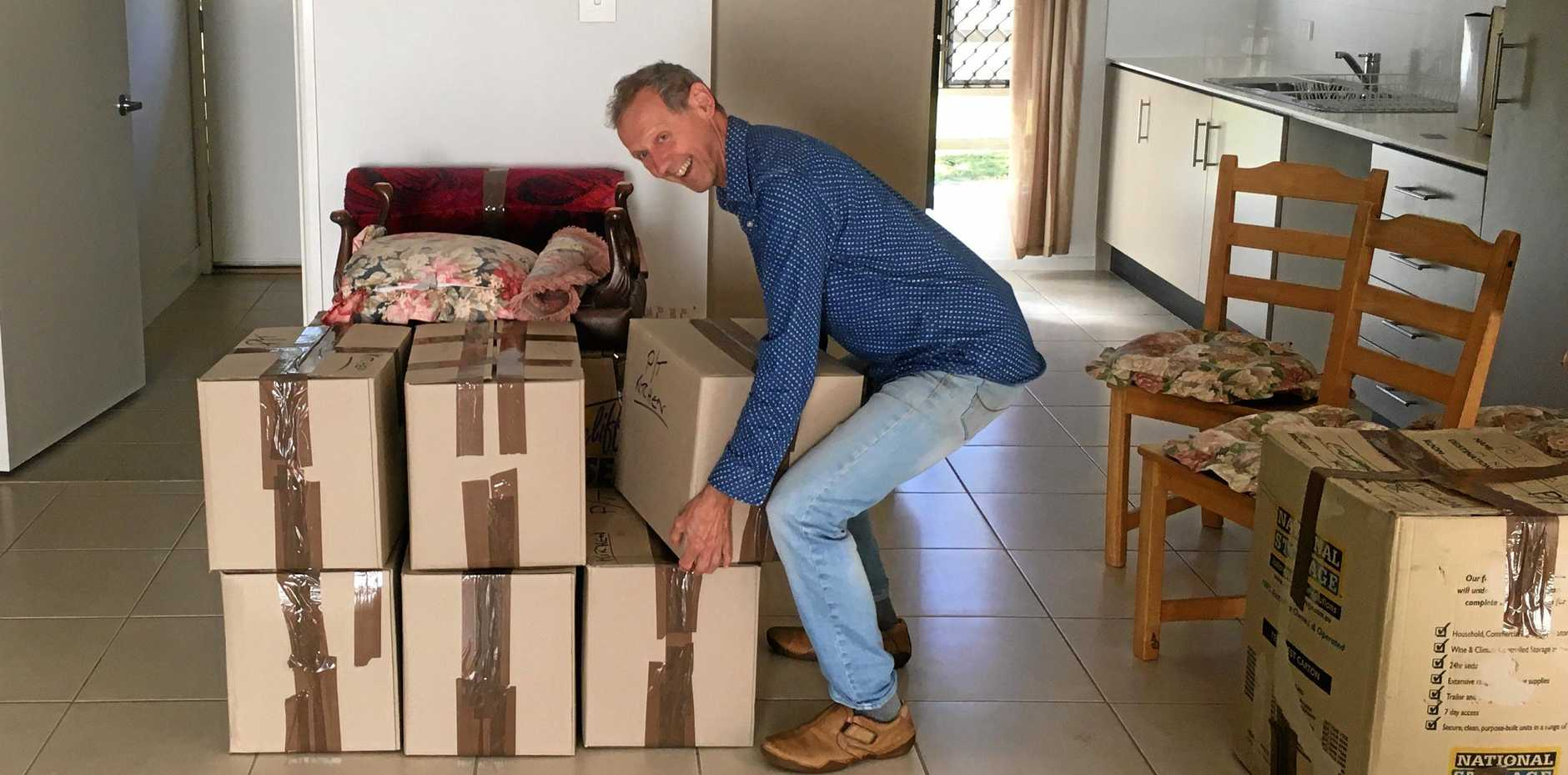 WELCOME ARRIVAL: Eric von Nida, from Carinity Our House, unloads boxes of household goods donated to a disability services client with no possessions.