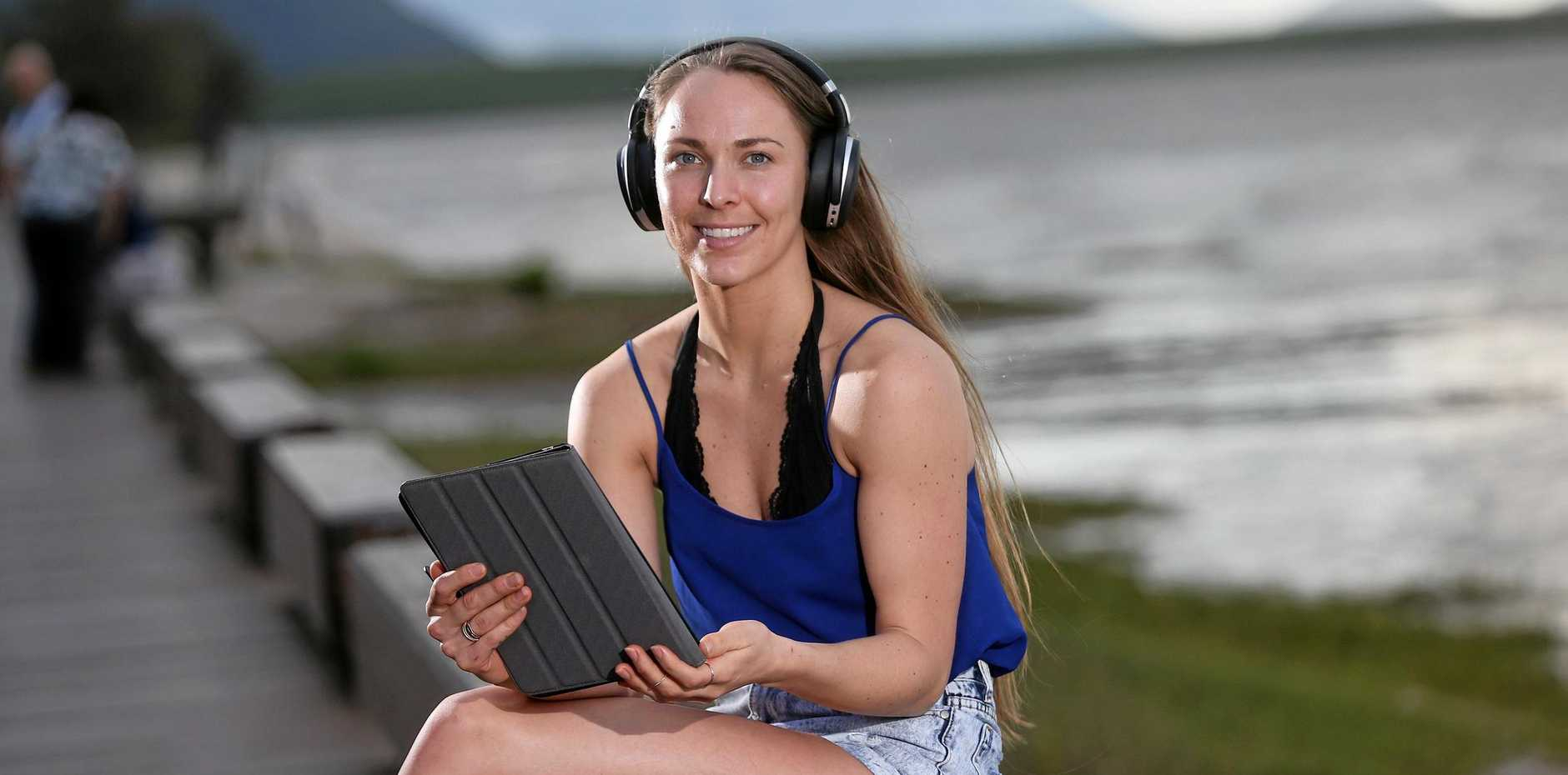 SOUND OF SILENCE: Alexandra Kwakernaak tries out the Sennheiser wireless noise cancelling headphones that new subscribers will receive when they sign a 12 month subscription with the Coffs Coast Advocate.
