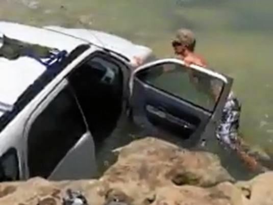 Video footage of a motorist bogged at Rainbow Beach has gone viral for all the wrong reasons.
