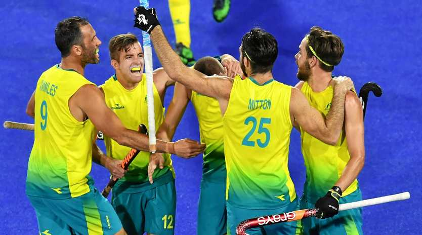 Trent Mitton  of Australia celebrates scoring a goal during the mens pool A Hockey match between Australia and New Zealand on day seven of the XXI Commonwealth Games at the Gold Coast Hockey Centre on the Gold Coast, Australia, Wednesday, April 11, 2018. (AAP Image/Darren England) NO ARCHIVING, EDITORIAL USE ONLY