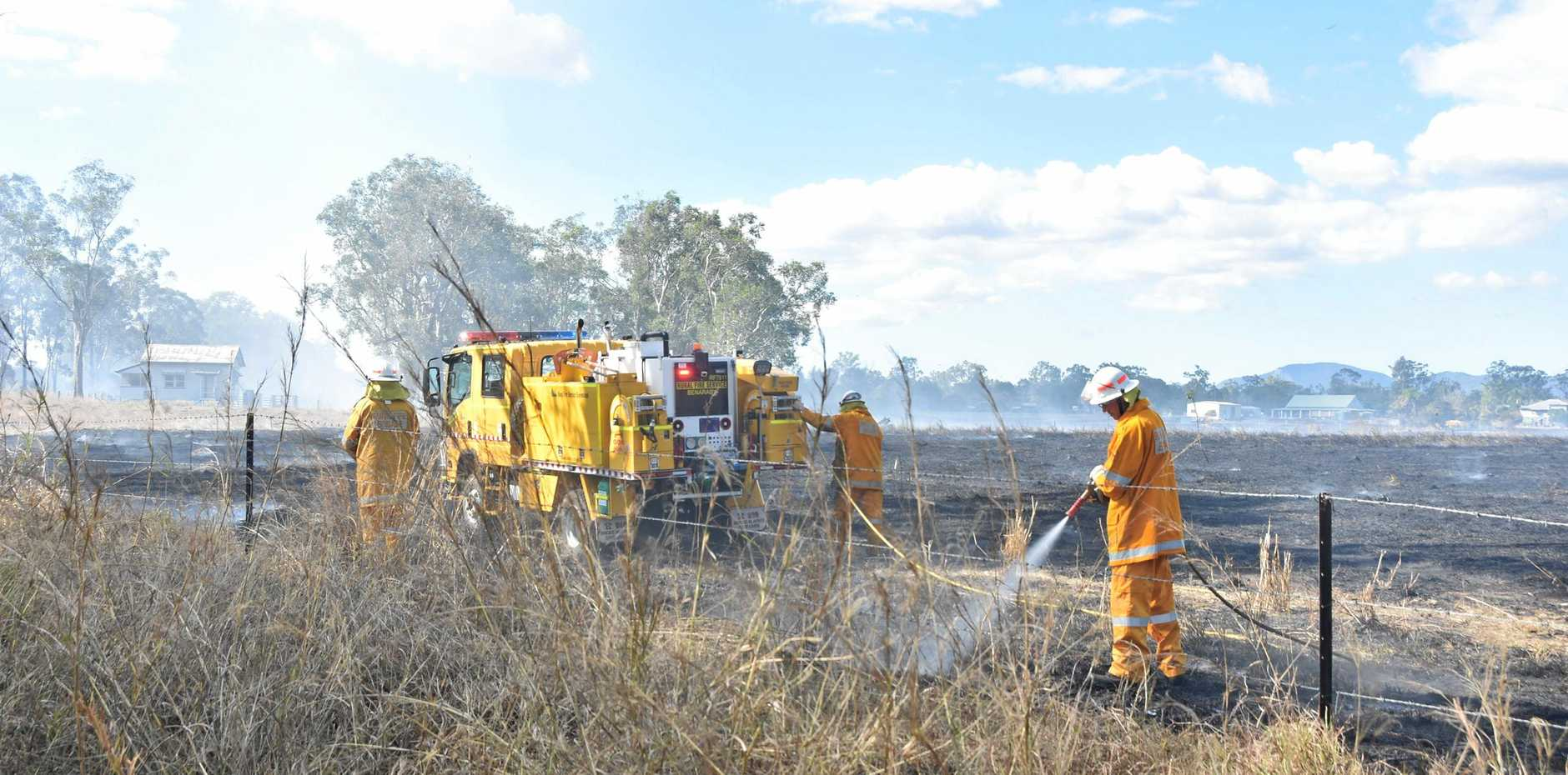 CLOSE CALL: Rural firefighters douse embers after putting out a fire at Bororen.