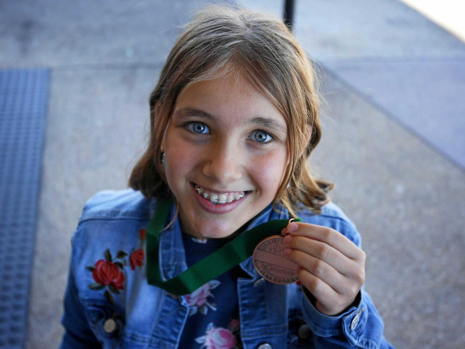 Madeleine Suttie with her medal.