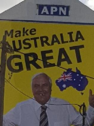 A defaced Clive Palmer billboard.