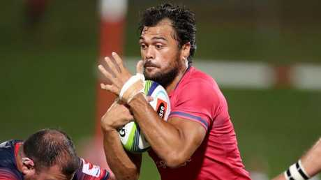 Karmichael Hunt makes a charge for the Queensland Reds. Picture: Darren England.
