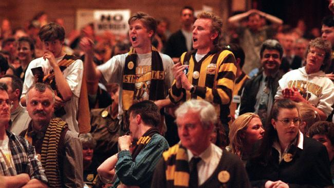 Angry Hawk fans at Camberwell Civic Centre for the merger meeting in September 1996.