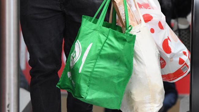 Coles will keep giving away free plastic bags for the foreseeable future after consumer outrage over having to remember reusable bags. (Pic: Peter Rae/AAP)