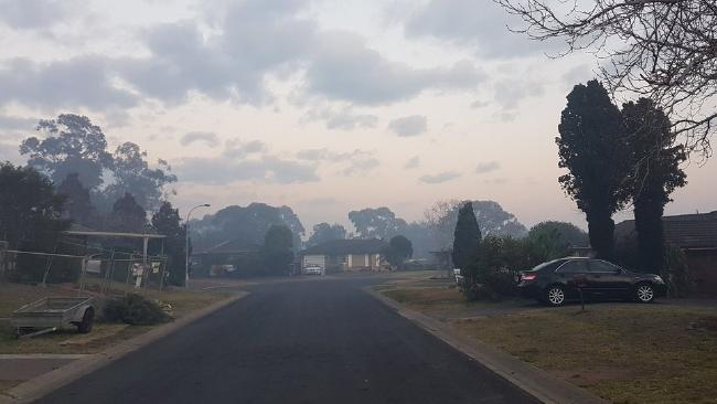 Schools have been forced to keep children indoors due to thick smoke from an uncontrolled bushfire. Picture: Twitter/@JohnnyEuphoric