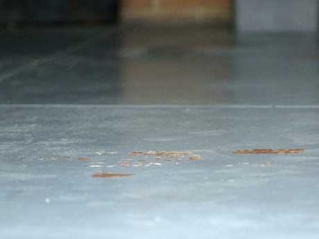Blood on the garage floor of Mr Singaravelu's Mill Park home where he was stabbed. Picture: Sarah Matray