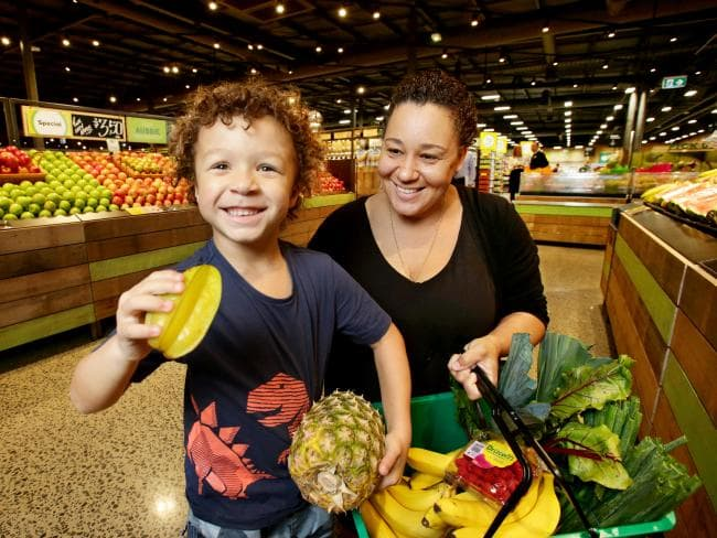 Lauren Carfrae and son Edwin Carfrae, 5, get a sneak peek at the fruit and vegetable section. Picture: Steve Pohlner/AAP