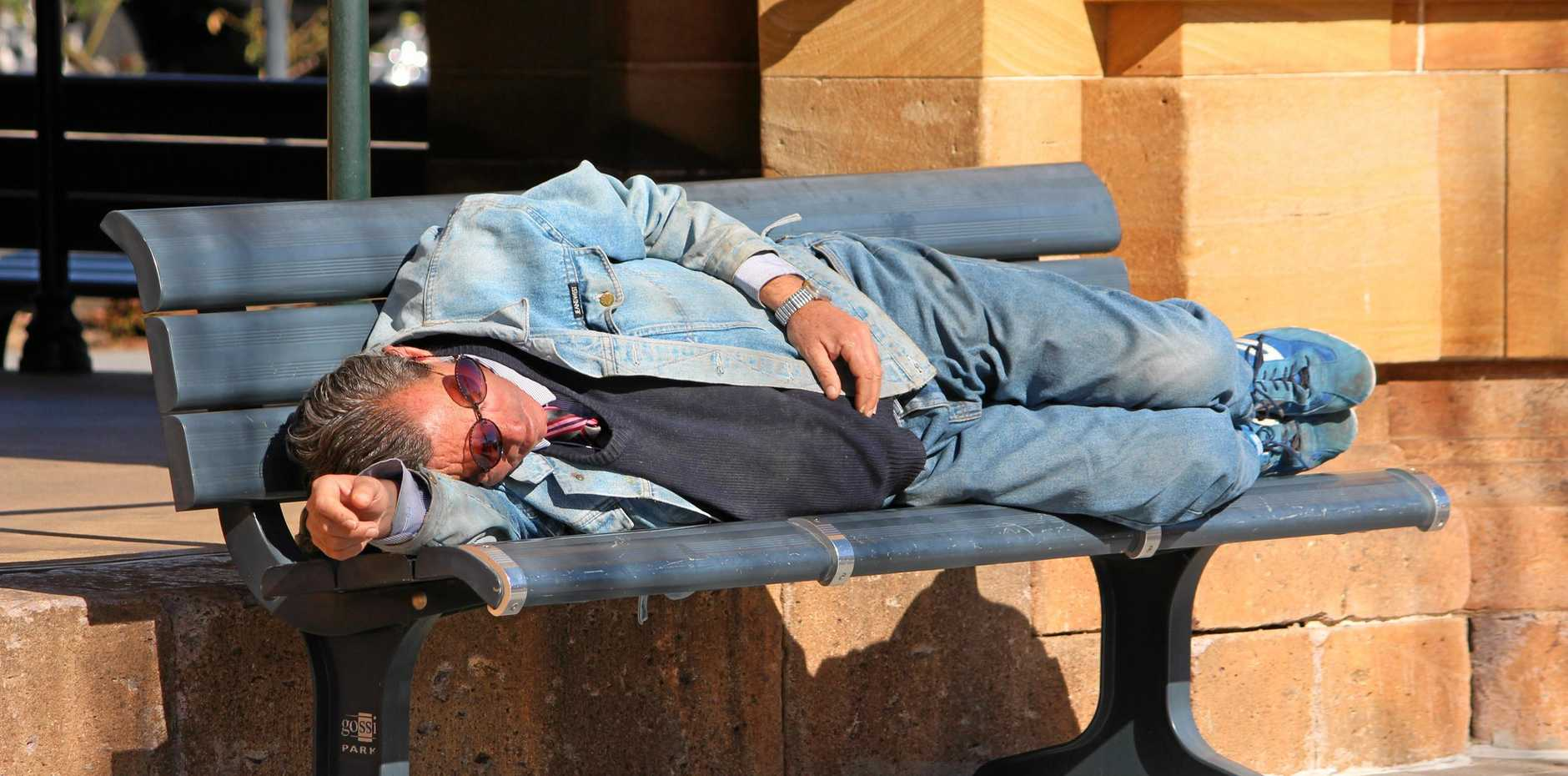 A man sleeps rough on bench outside the post office in the Warwick CBD. Homelessness and the housing shortage are issues that are affecting a number of people in the Southern Downs community.